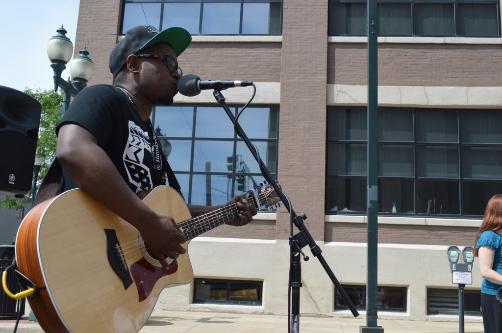 Singer/songwriter Ace Jones performs during the first Downtown Farmers Market of the season in Cedar Rapids, Iowa. (photo/Cindy Hadish)