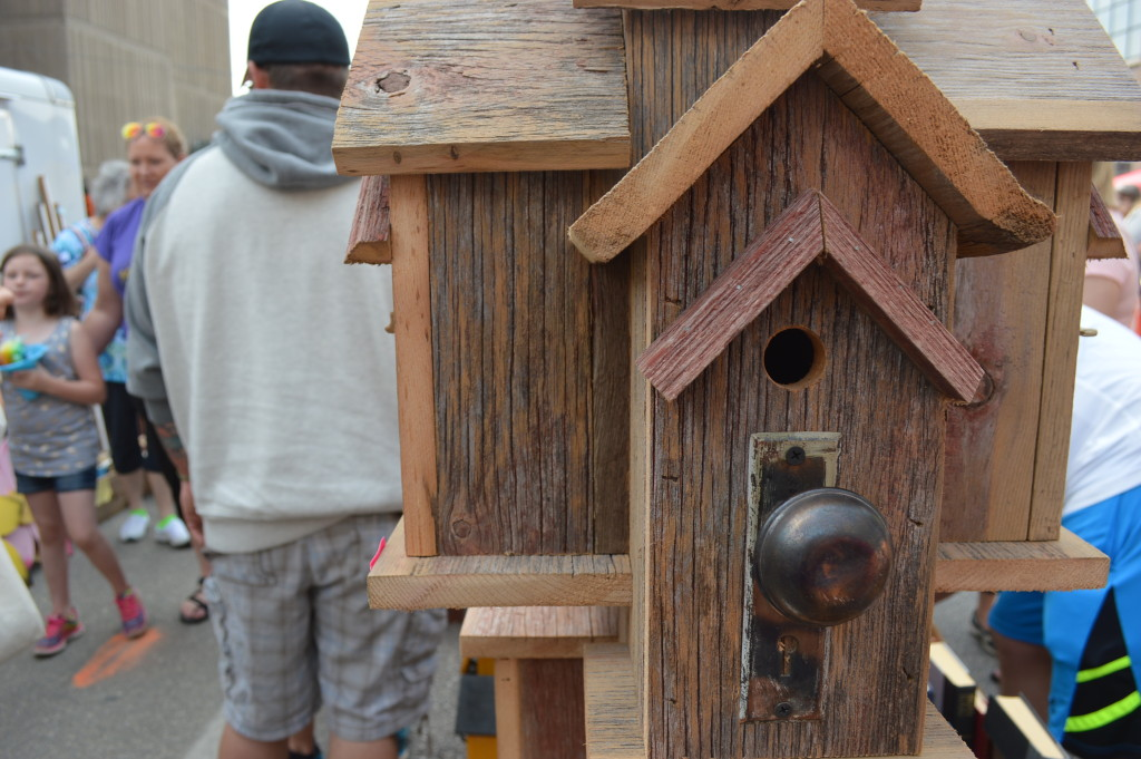 Birdhouses, signs and more crafted by the Barn Board Factory of Elgin from reclaimed barn wood were popular items at the Downtown Farmers Market. (photo/Cindy Hadish)