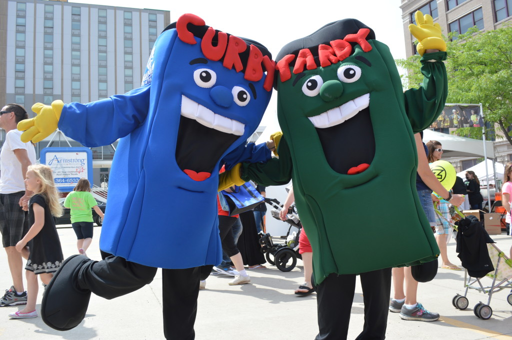 Curby and Yardy mascots were on hand at the Downtown Farmers Market to encourage recycling and composting in Cedar Rapids. (photo/Cindy Hadish)
