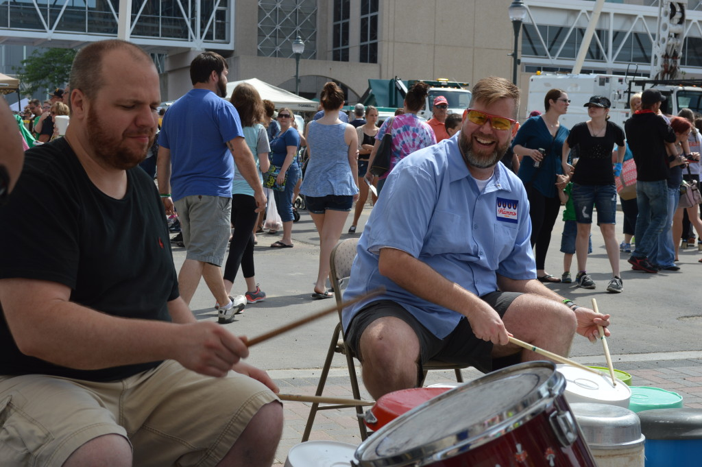 Members of Junk Funk perform during the kickoff of the 2015 Downtown Farmers Market in Cedar Rapids, Iowa. (photo/Cindy Hadish)