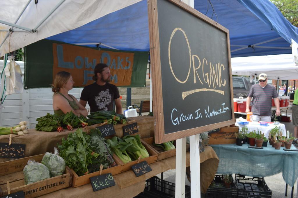 Low Oaks Farm, located near Decorah, sells organic vegetables during the Downtown Farmers Market in Cedar Rapids, Iowa. (photo/Cindy Hadish)