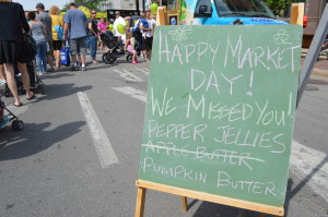 Vendors were excited to welcome back customers, as the Downtown Farmers Market kicked off its 10th anniversary season on June 6, 2015. (photo/Cindy Hadish)