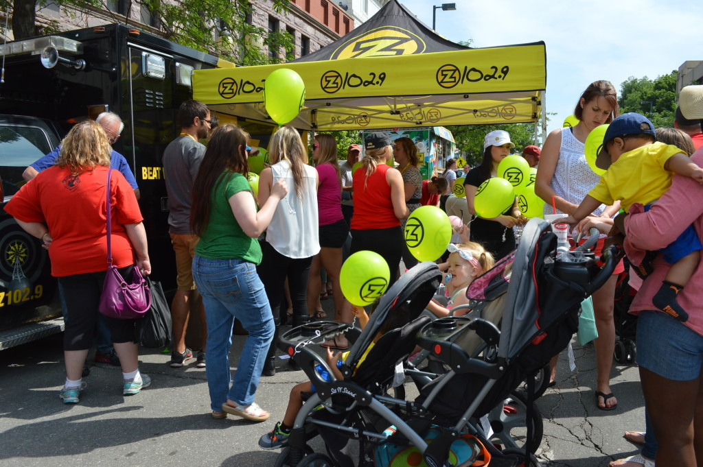 Balloons given away by local radio station, Z102.9, were popular with children during the Downtown Farmers Market. (photo/Cindy Hadish)