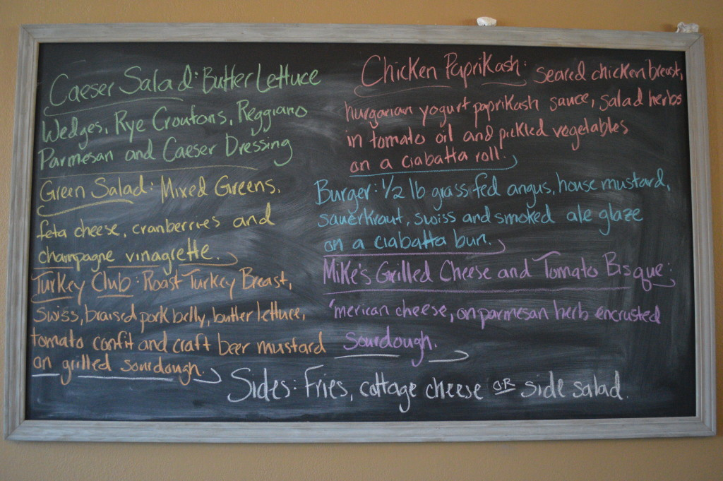 A chalkboard menu displays the items offered during the soft opening at Sauce Bar & Bistro on Tuesday, June 23, 2015. (photo/Cindy Hadish)