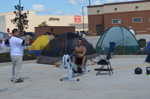"A customer waiting in line to be one of the ""First 100"" to win a free year of meals at Chick-fil-A works out in the parking lot of the new site on Edgewood Road SW in Cedar Rapids. (photo/S. Bell)"