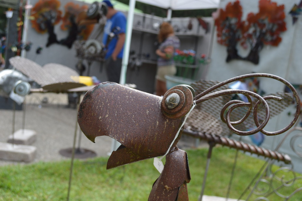 Garden art attracted buyers at the Brucemore Garden & Art Show, including works by Metalworks of Cedar Rapids. (photo/Cindy Hadish)