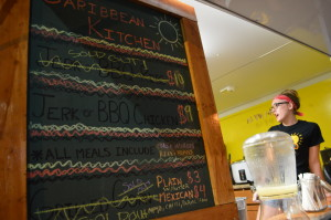 The Caribbean Kitchen's stand was so busy that some items sold out during Market After Dark. (photo/Cindy Hadish)