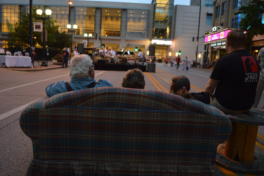 Couches provided a cozy place to watch bands perform during the first Market After Dark in downtown Cedar Rapids. (photo/Cindy Hadish)