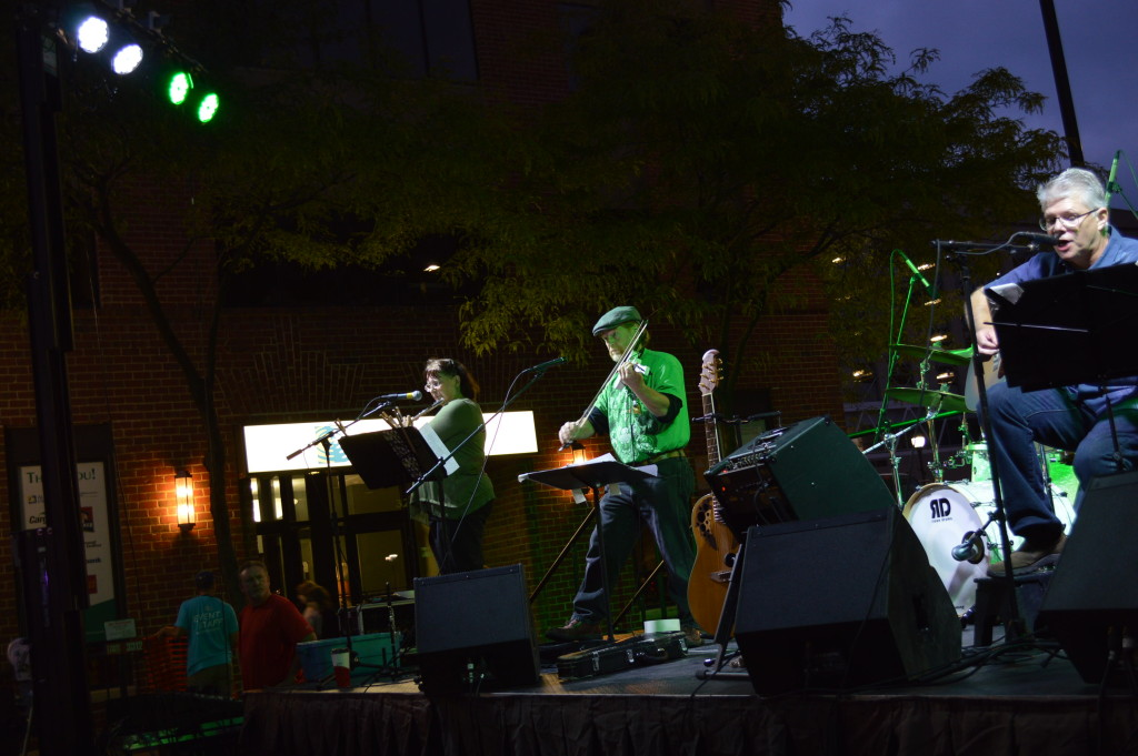 Irish Jam entertains the crowd on the main stage Saturday, Aug. 29, 2015, during Market After Dark. (photo/Cindy Hadish)