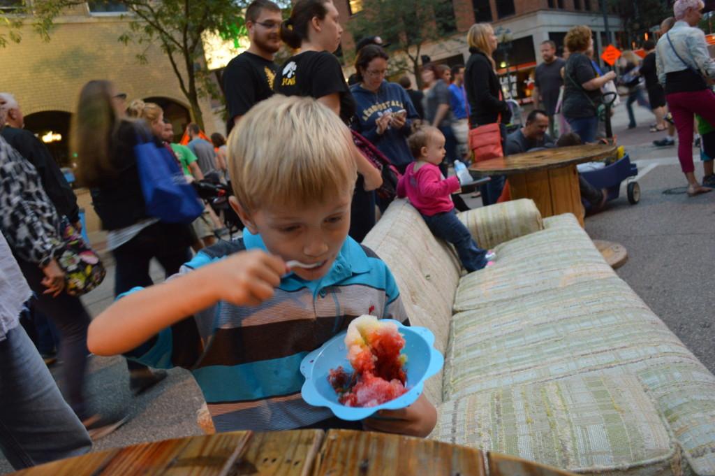 Children found plenty to eat at the first Market After Dark in downtown Cedar Rapids. (photo/Cindy Hadish)