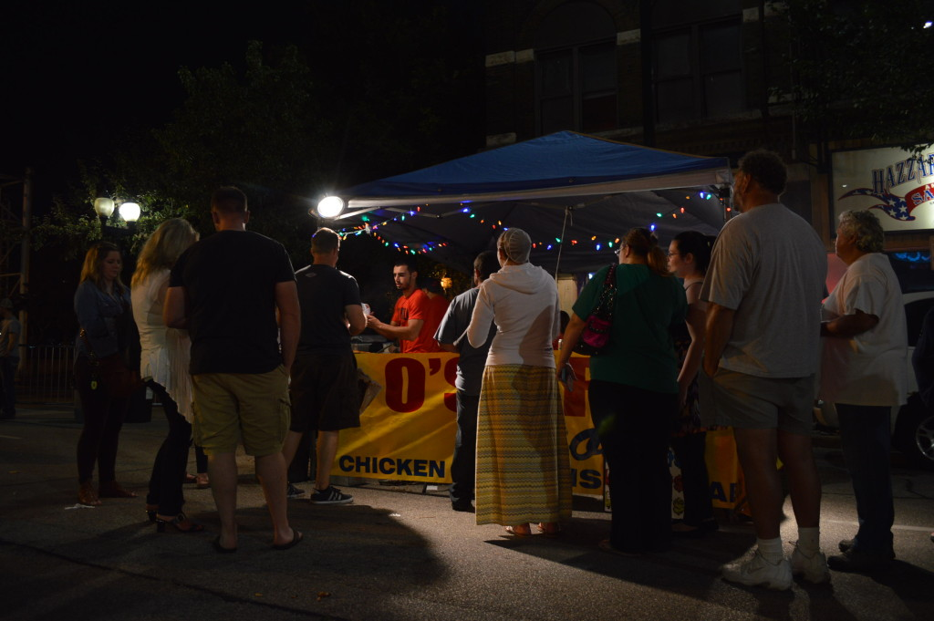 Customers line up for food from O's Grill on Saturday, Aug. 29, during the first Market After Dark in Cedar Rapids. (photo/Cindy Hadish)