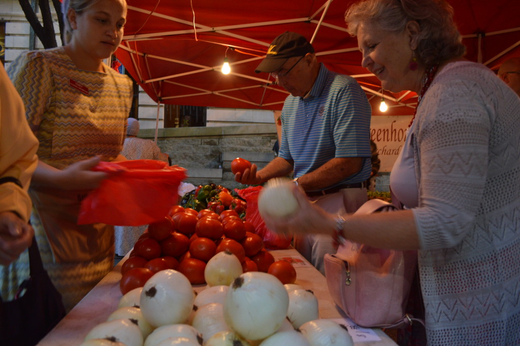 Stillwater Greenhouse, a mainstay at the Downtown Farmers Market, was one of about 80 vendors at the first Market After Dark in Cedar Rapids. (photo/Cindy Hadish)