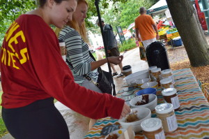 Customers sample a variety of nut butters this summer during the Uptown Marion Farmers Market. (photo/Cindy Hadish)