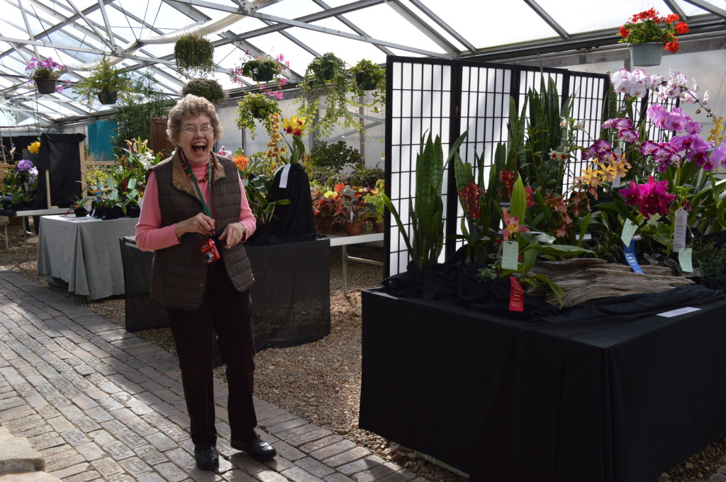 Bill Snyder's wife, Jean Snyder, enjoys the Eastern Iowa Orchid Show and Sale as she walks through the Noelridge Greenhouses. (photo/Cindy Hadish)
