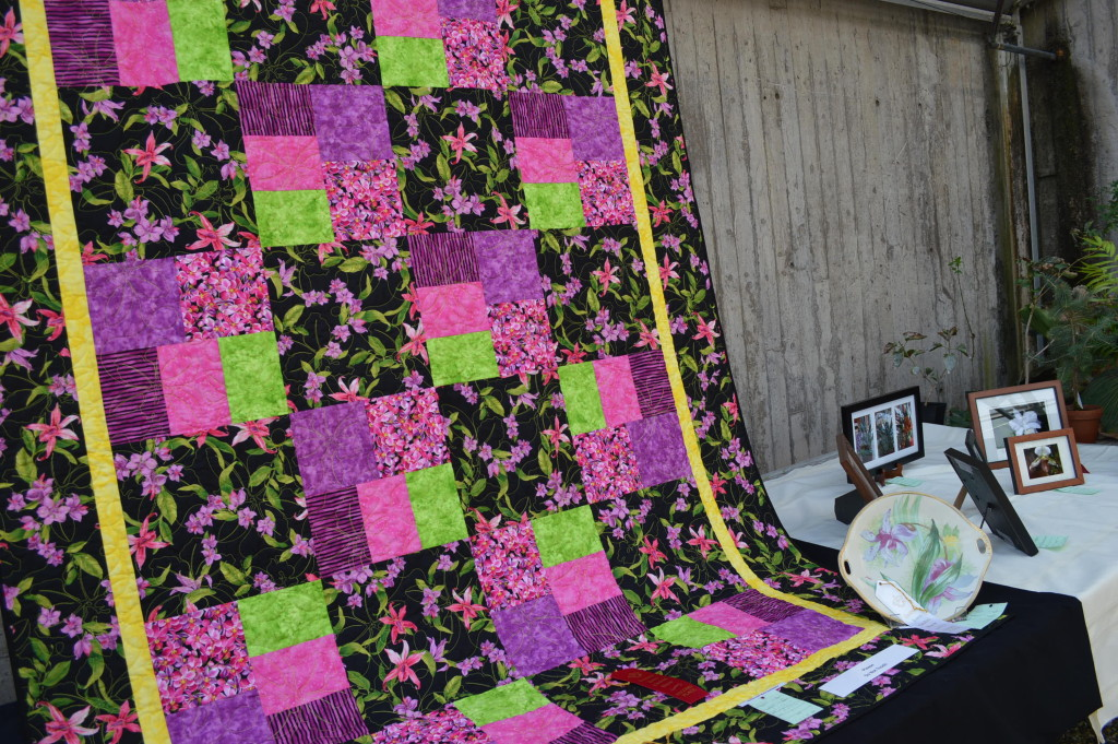 Besides orchid plants, artwork and other displays were shown at the Eastern Iowa Orchid Show and Sale, including this quilt by Dorothy Hampton. (photo/Cindy Hadish)