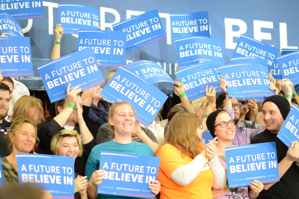 Supporters of Bernie Sanders hold signs during a rally Sunday, Dec. 13, 2015, at Cornell College in Mount Vernon, Iowa. (photo/Cindy Hadish)