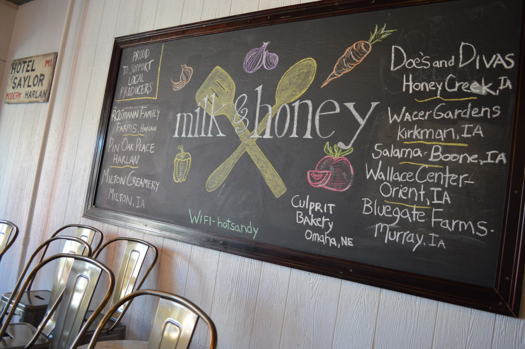 A chalkboard menu displays the local producers used at Milk & Honey, a cafe in Harlan, Iowa. (photo/Cindy Hadish)