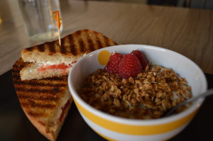 A yogurt parfait, alongside a grilled goat cheese sandwich on sourdough, are shown at Milk & Honey in Harlan, one of the restaurants on the Western Skies Scenic Byway that feature local foods. (photo/Cindy Hadish)