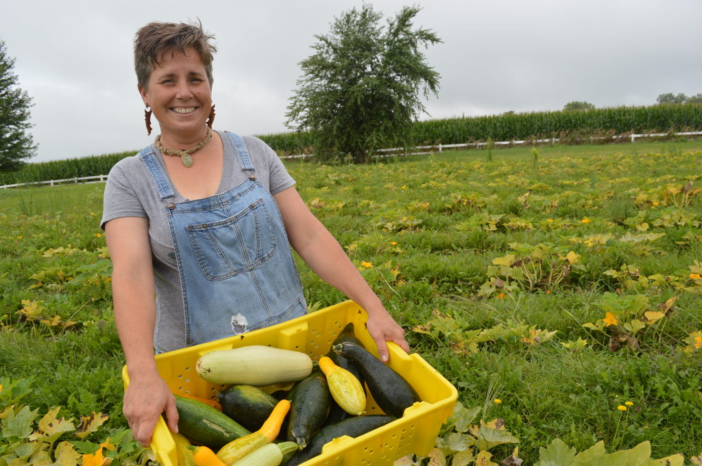 Sonia Kendrick is shown with some of the squash she harvested in 2015. Kendrick, the founder of Feed Iowa First, was named one of Radish Magazine's 2015 award winners for her work. (photo/Cindy Hadish)