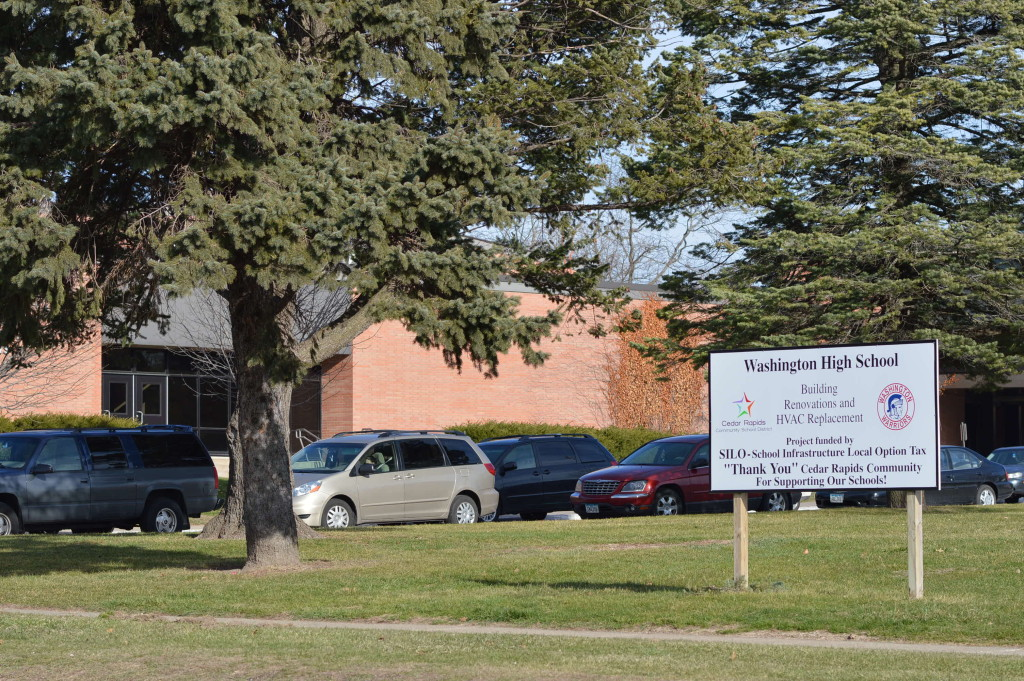 A sign outside of Washington High School notes the project that took place inside the school. The school was closed this summer over concerns related to asbestos removal. (photo/Cindy Hadish)