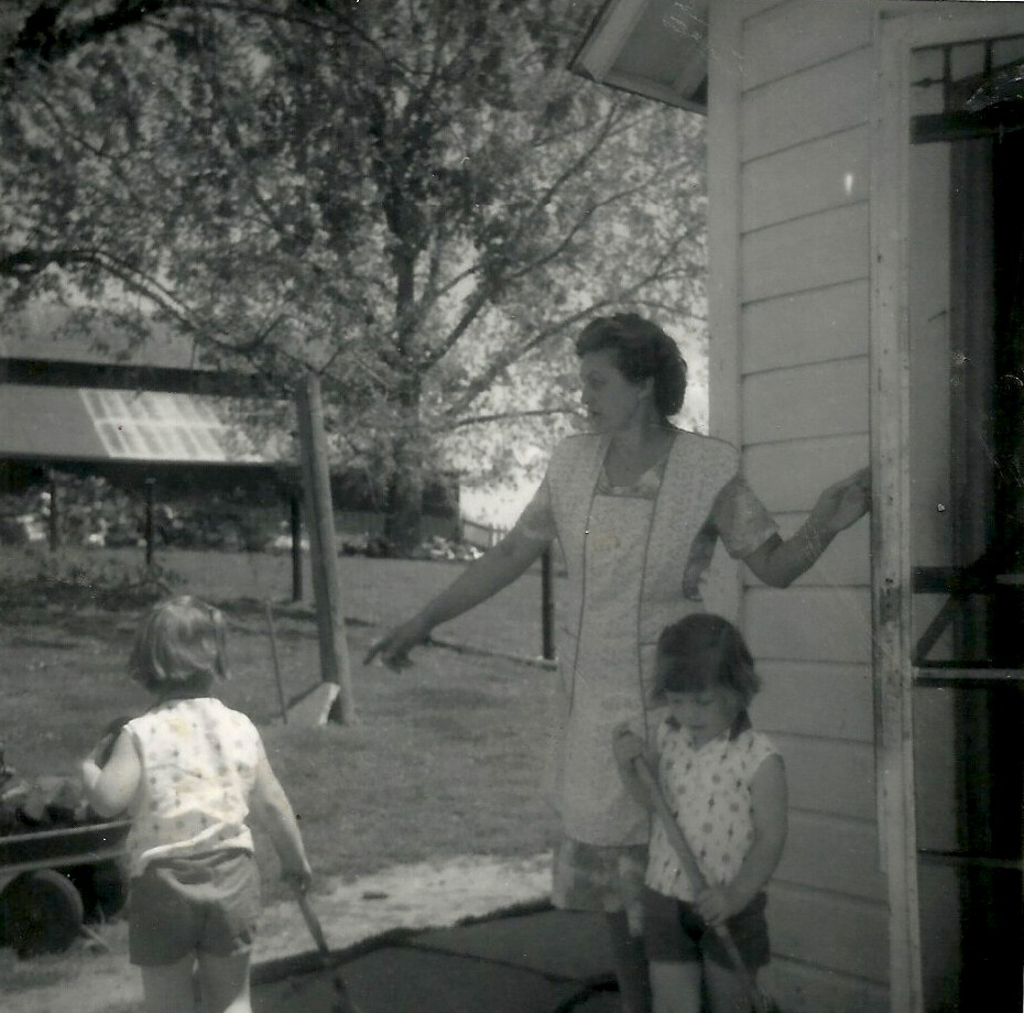Elsie Musel is shown at her farm in rural Chelsea, Iowa, with two of her grandchildren, in 1964. (photo courtesy, Gregg Hadish)