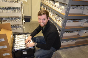 Zach Row-Heyveld, Seed Savers Exchange Inventory Technician, prepares seed for shipment. (photo/Seed Savers Exchange)