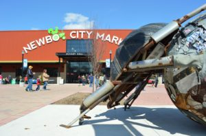 A dung beetle metal sculpture greets visitors at a past EcoFest outside of the NewBo City Market in Cedar Rapids. (photo/Cindy Hadish)