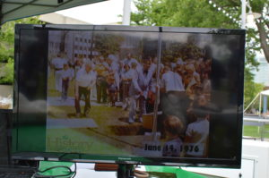 Images of the burial of the time capsule were shown during the May 20 event. (photo/Cindy Hadish)