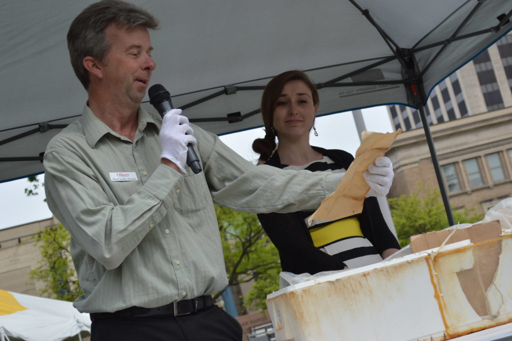 Mark Stoffer Hunter and Jami Roskamp of The History Center show contents of a time capsule on May 20, 2016. The time capsule was buried in Greene Square Park in 1976. (photo/Cindy Hadish)