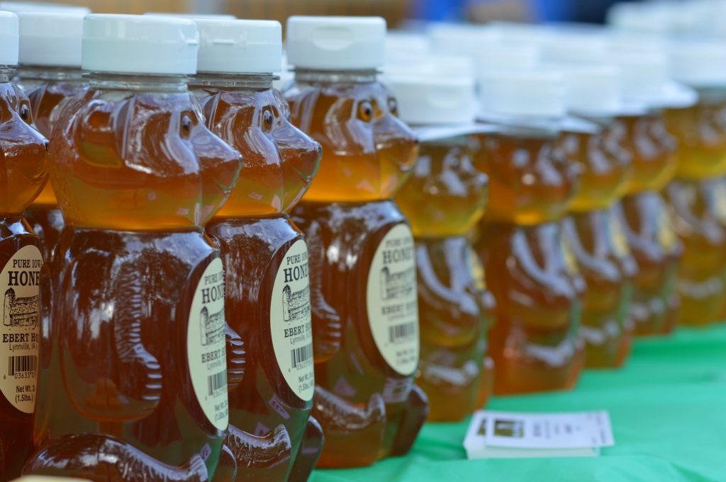 Honey bears are sold by Ebert Honey at the inaugural night farmers market at Lion Bridge Brewing Company in Cedar Rapids, Iowa. (photo/Cindy Hadish)