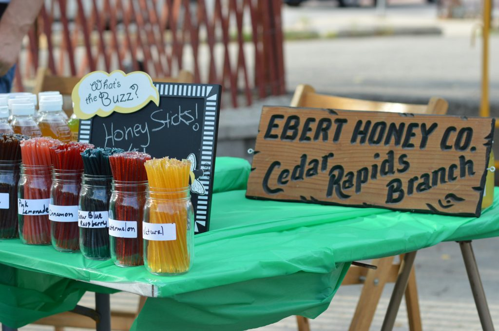 Ebert Honey sold honey sticks and more at the inaugural night farmers market at Lion Bridge Brewing Company in Cedar Rapids. (photo/Cindy Hadish)