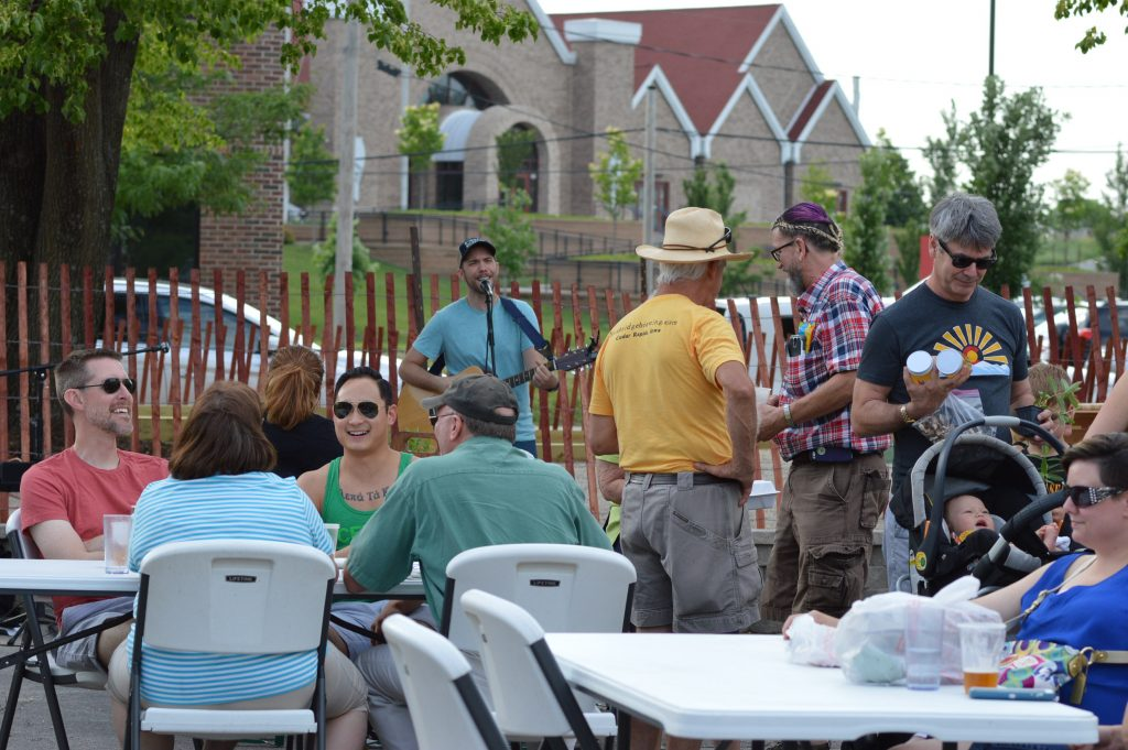 The crowd at Lion Bridge Brewing Company listens to live music during the debut of the night farmers market at Lion Bridge Brewing Company on Thursday, June 6, 2016. (photo/Cindy Hadish)