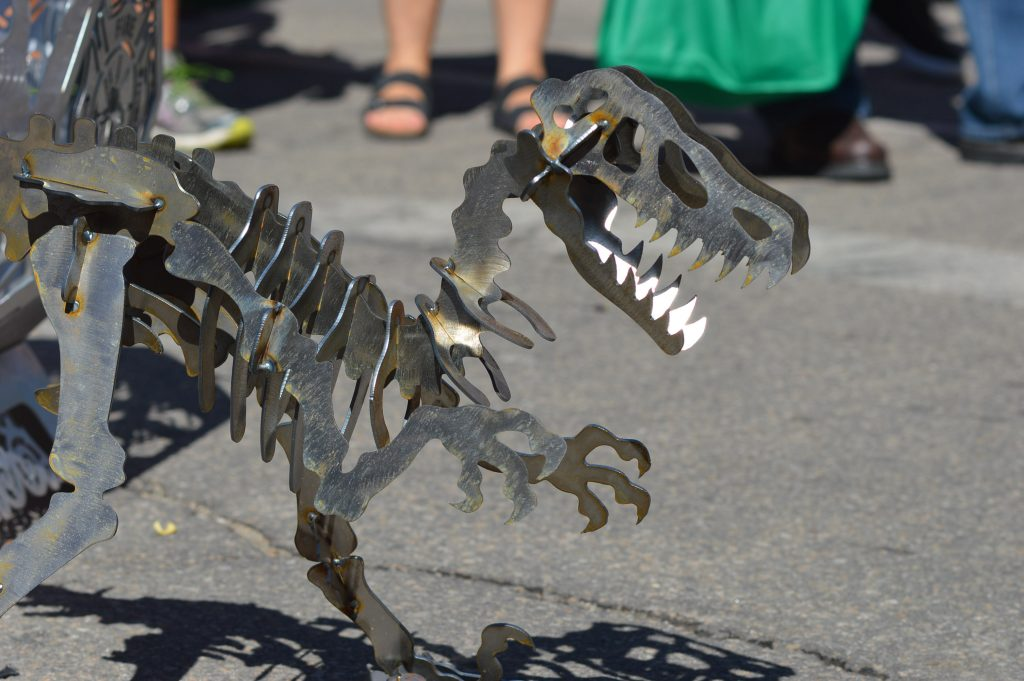 A dinosaur sculpture was among the items sold by Echo Valley Metalworks of West Union, Iowa, during the Downtown Farmers Market in Cedar Rapids. (photo/Cindy Hadish)