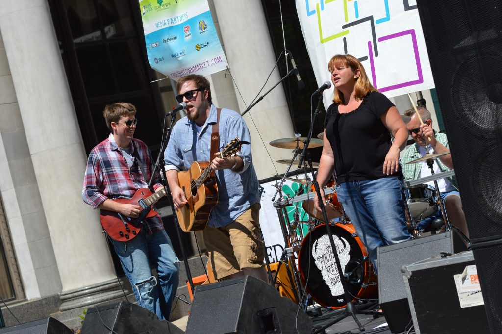 The Michael Reed Band, based in Waterloo, Iowa, performs during the opening day of the 2016 Downtown Farmers Market in Cedar Rapids. (photo/Cindy Hadish)