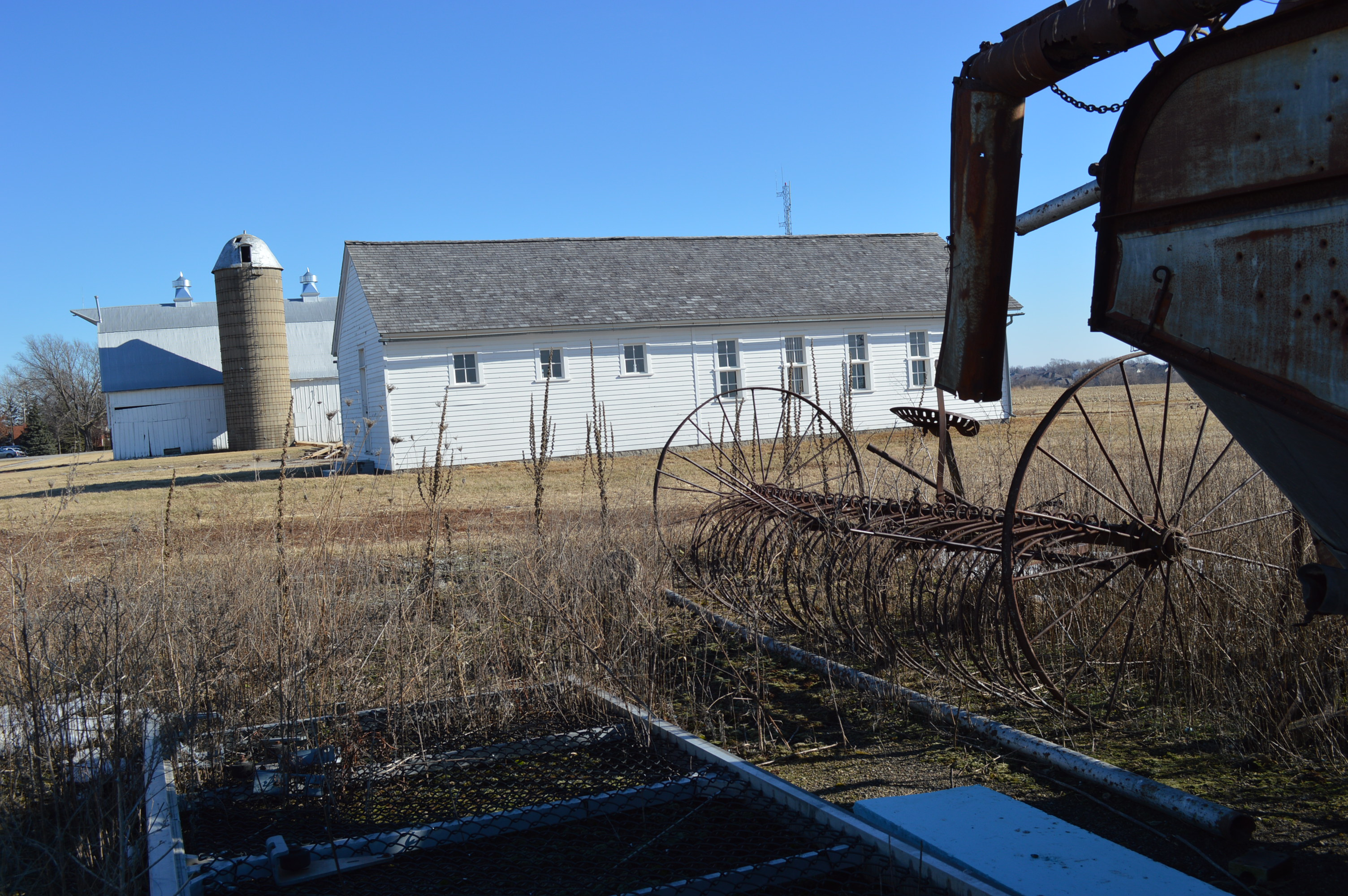 """Buildings, including the """"insane wing"""" are shown last year at the Johnson County Poor Farm. A Solstice Party and open house are planned at the farm. (photo/Cindy Hadish)"""