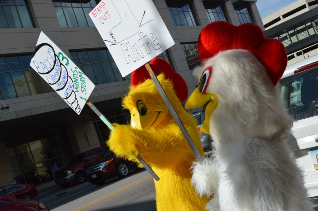 The rally against Donald Trump even brought out protesters in chicken costumes in the summer's heat on July 28, 2016. (photo/Cindy Hadish)