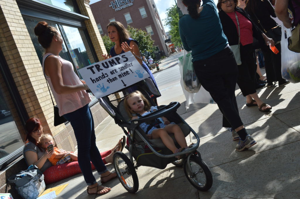 People of all ages joined in the protest against Republican presidential candidate Donald Trump in Cedar Rapids, Iowa. (photo/Cindy Hadish)