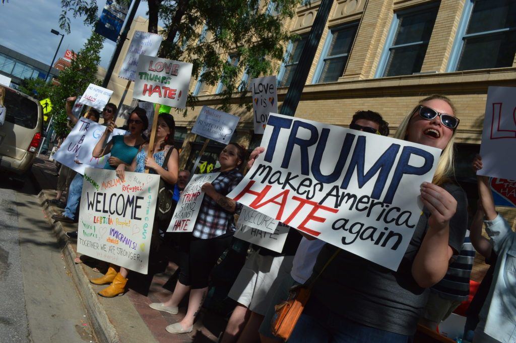 Protesters gather outside the Donald Trump rally in downtown Cedar Rapids, Iowa, on Thursday, July 28, 2016. (photo/Cindy Hadish)