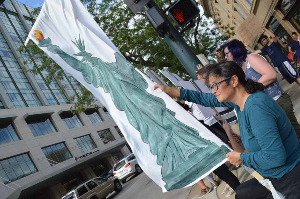 A lady liberty sign is hoisted in front of the DoubleTree by Hilton Hotel in downtown Cedar Rapids. (photo/Cindy Hadish)
