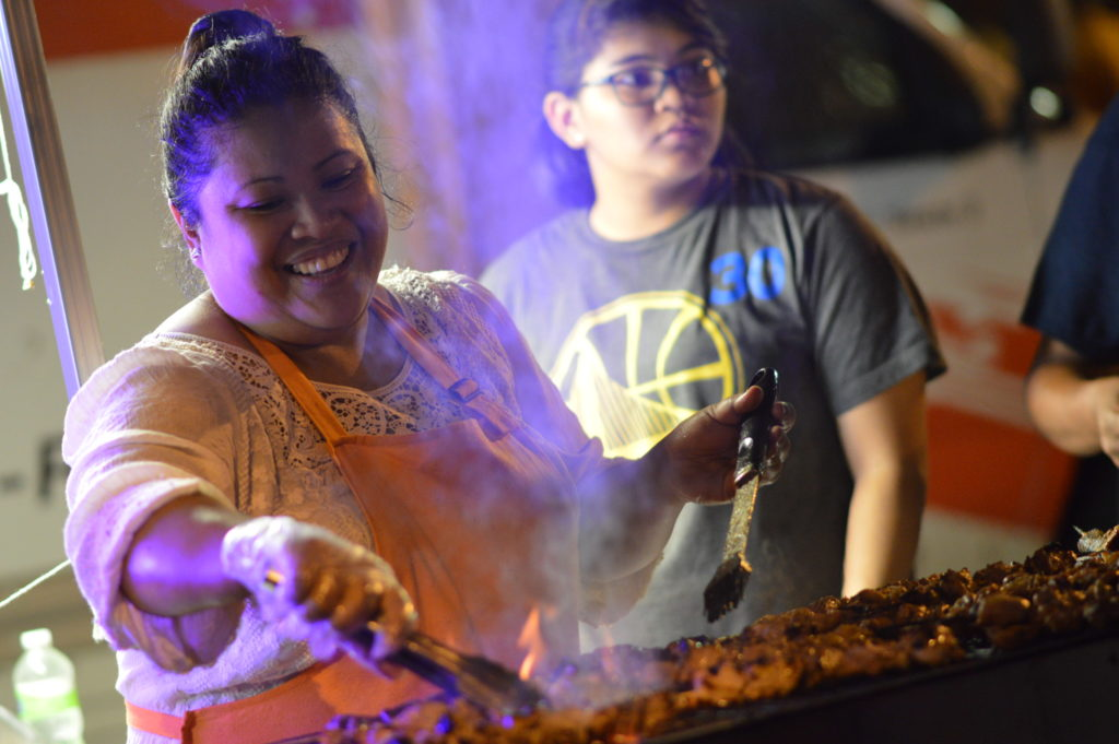 Food is grilled at the Culata International Cuisine stand Aug. 27, 2016, at Market After Dark. (photo/Cindy Hadish)