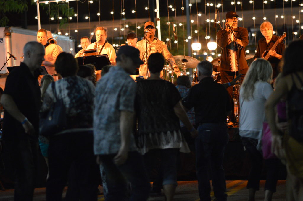 A crowd dances as Funk Stop performs during Market After Dark on Aug. 27, 2016. (photo/Cindy Hadish)
