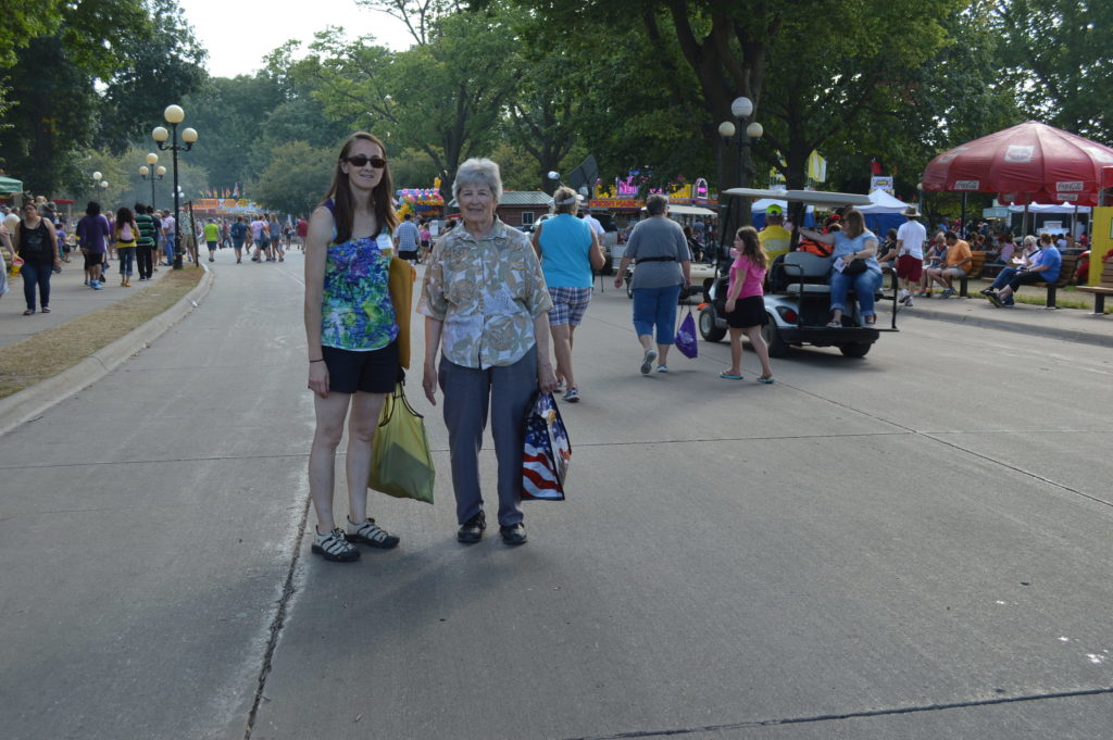 Margaret Wolter and Dorothy Martens make their way outside the Pioneer Pavilion after the award ceremony for Heritage Farms at the Iowa State Fair. (photo/Cindy Hadish)