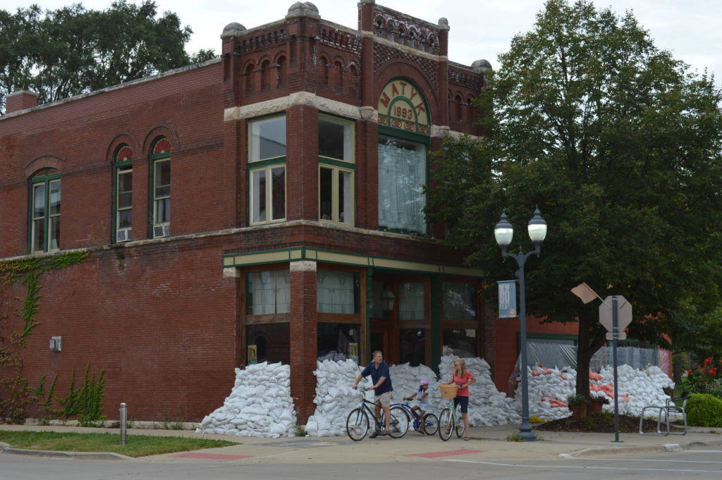 Cyclists ride past the Matyk Building in New Bohemia on Sunday, Sept. 25, 2016. (photo/Cindy Hadish)