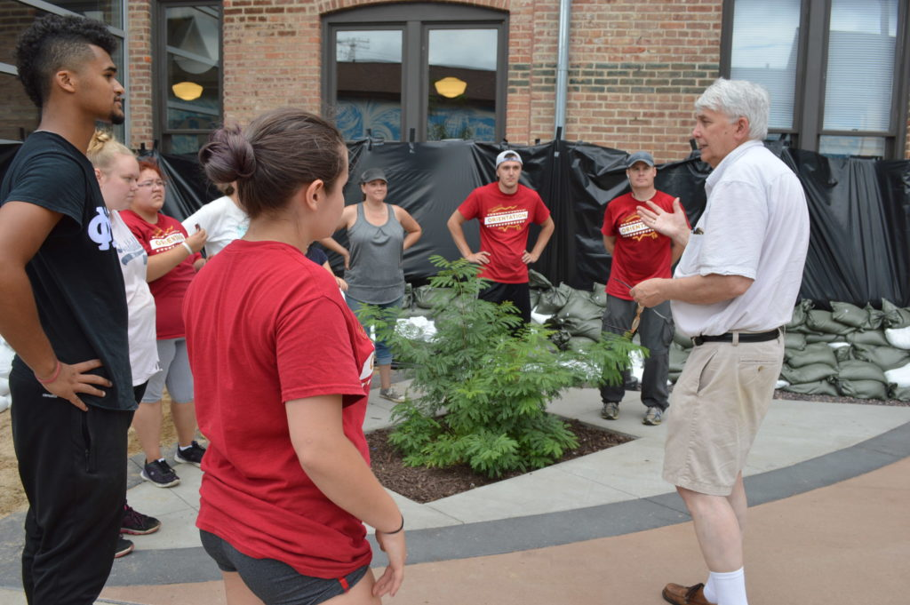 Mel Andringa thanks volunteers from Coe College outside of CSPS Hall , 1103 Third St. SE. (photo/Cindy Hadish)