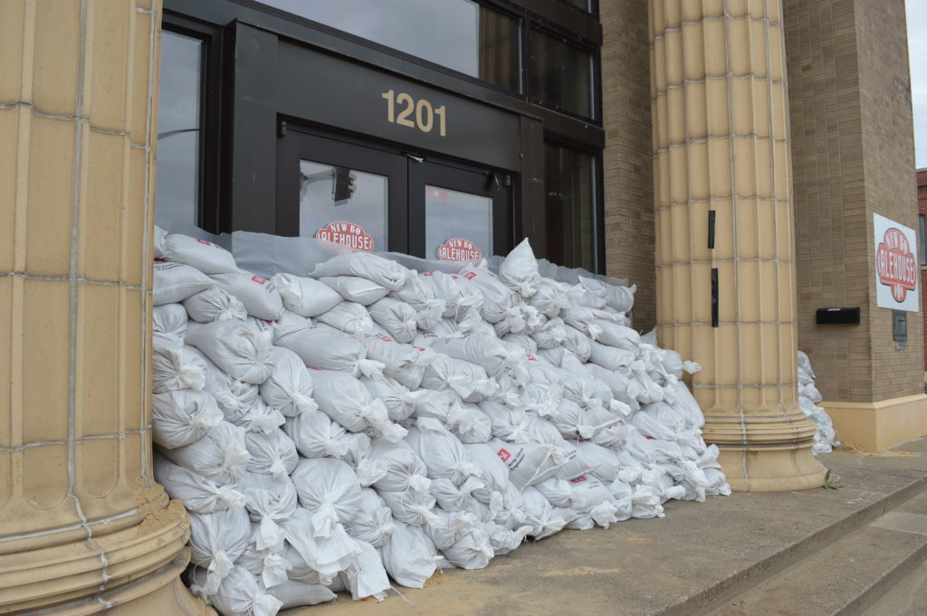 Sandbags line the doors of NewBo Alehouse on Sunday, Sept. 25, 2016, in advance of predicted flooding in Cedar Rapids, Iowa. (photo/Cindy Hadish)