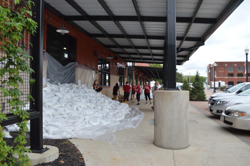 Piles of sangbags line the NewBo City Market in Cedar Rapids, Iowa. (photo/Cindy Hadish)