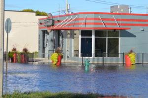Water begins to recede Sept. 28, 2016, around the Kickstand Bar & Grill in Cedar Rapids, Iowa. (photo/Cindy Hadish)