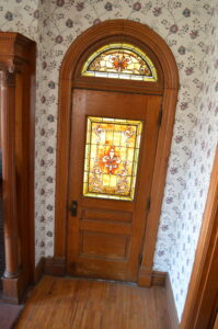 Original stained glass windows add character to the Meek Mansion in Bonaparte, Iowa. (photo/Cindy Hadish)
