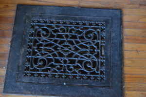 A metal floor grate is shown inside the Meek Mansion in Bonaparte, Iowa. (photo/Cindy Hadish)